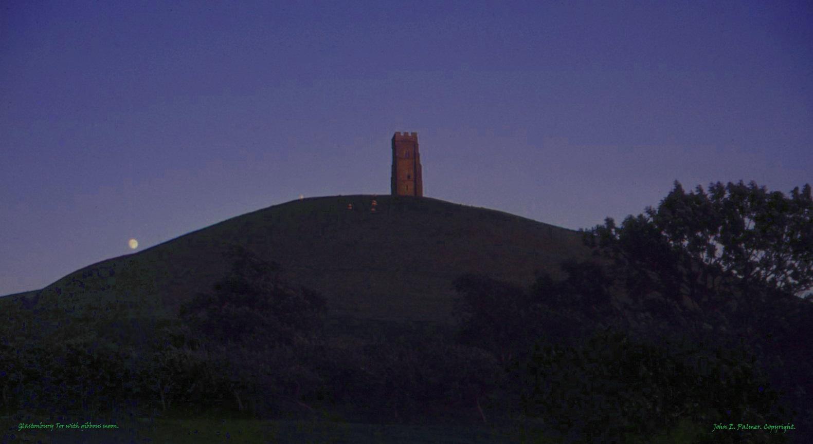 Glastonbury Tor with gibbous moon. (titled).