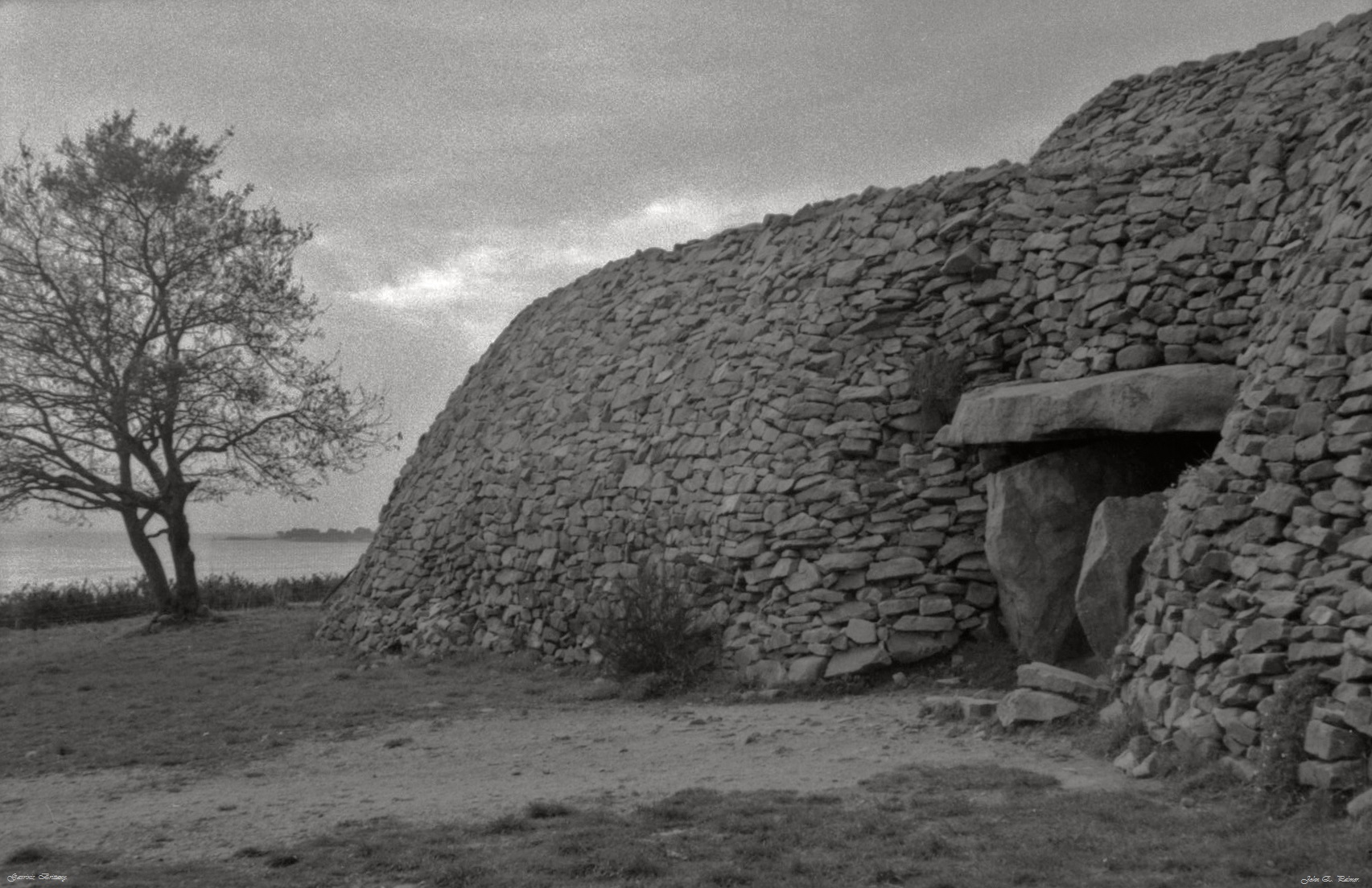 Facade of Gavrinis chambered cairn at Entry to passage.    Photo copyright: John Palmer