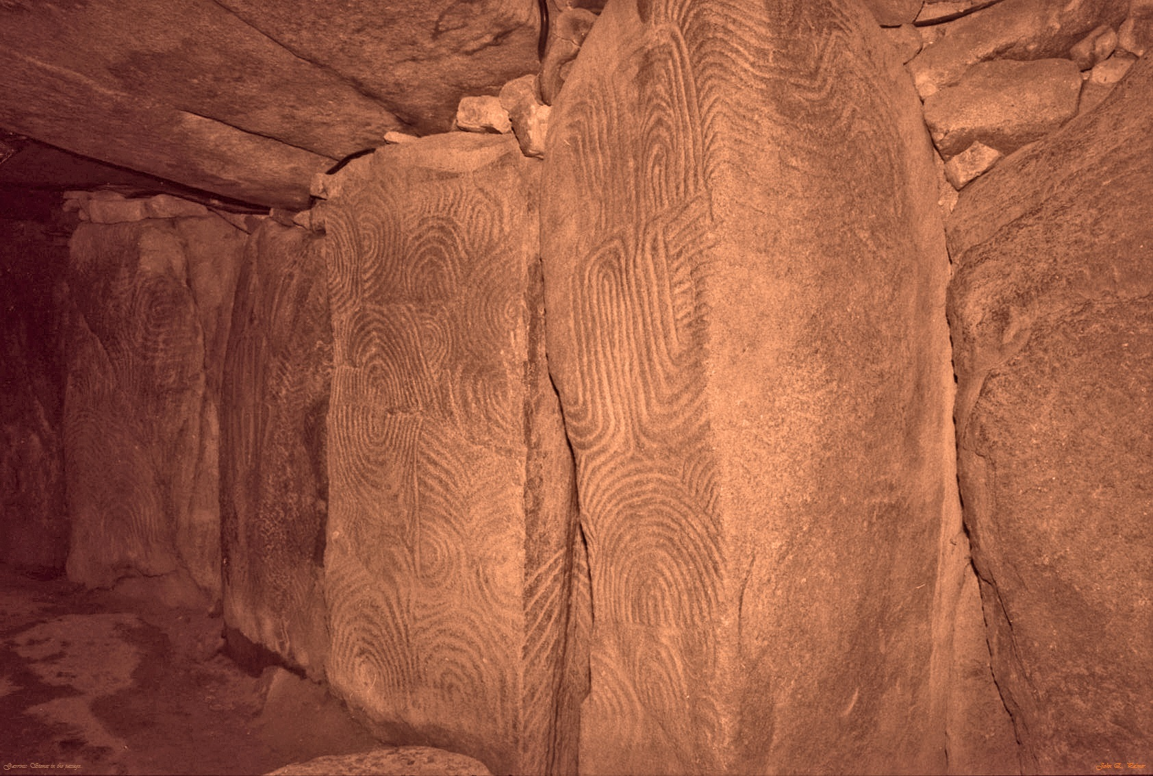 Decorated artwork on stones in the passage leading to the chamber.        Photo copyright: John Palmer