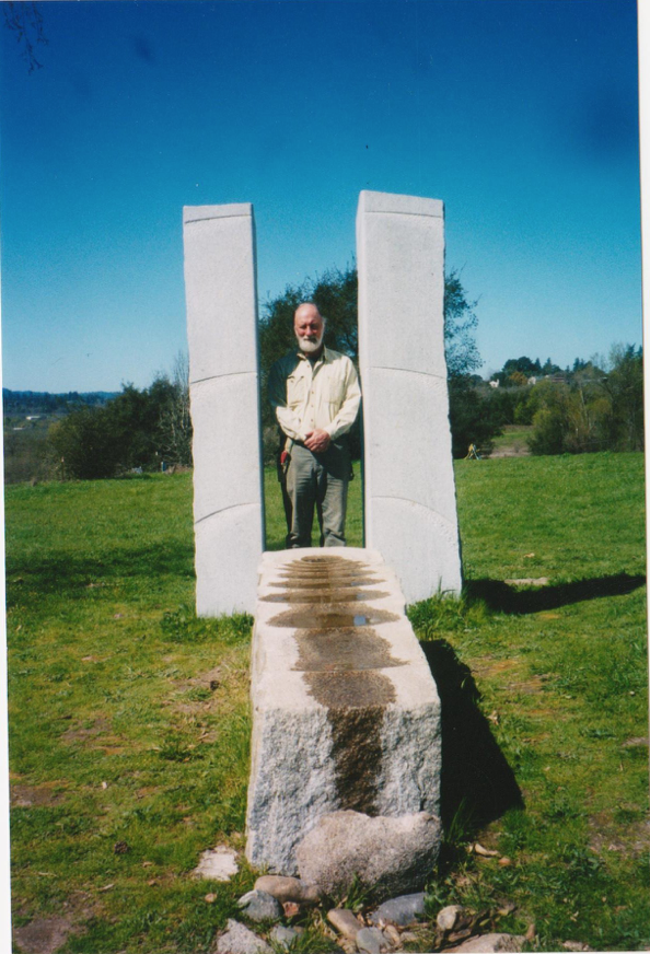"The author with Masayuki Nagase's granite ""Prayer for Peace."" The sculptor has written that it ""...symbolizes the source of the human spirit and our consciousness for peace."" - Photo by Kate Broderson"